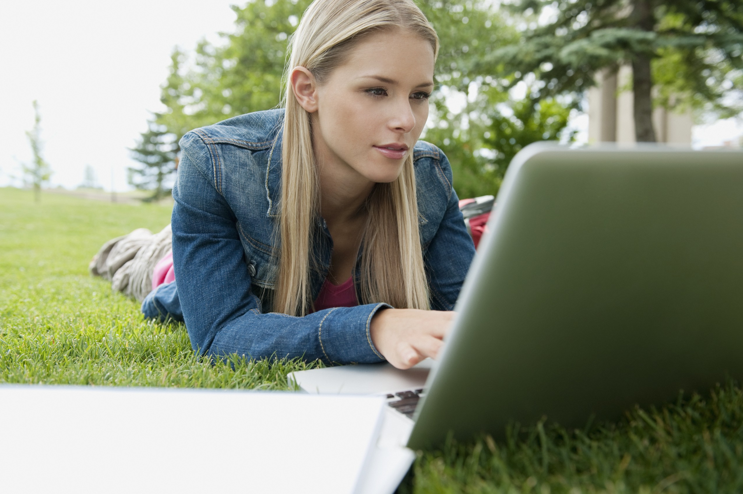 Student studying outdoors --- Image by © Rachel Frank/Corbis
